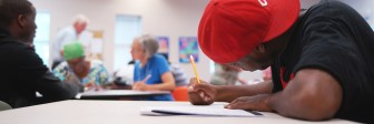 A GED student works in class.