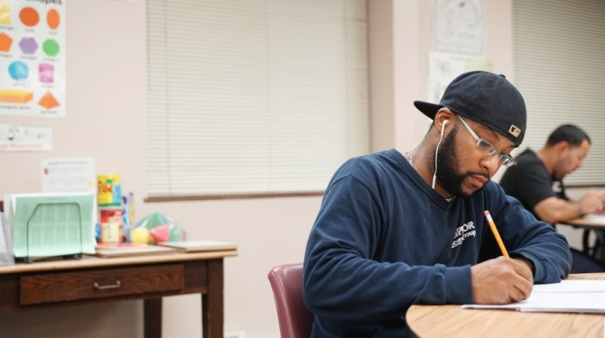 A student works in the evening class at Seeds of Literacy.