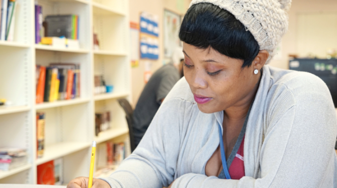 A student studies for her GED in Cleveland's east side.
