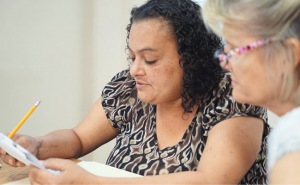 A tutor helps an adult literacy student with GED math skills.