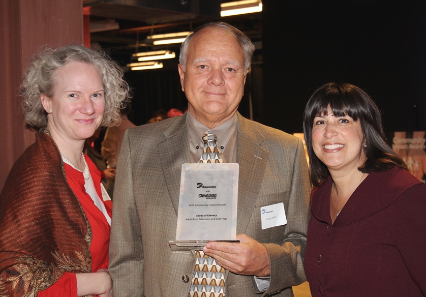 Development Officer Jo Steigerwald, Board President George Miller, and Executive Director Bonnie Entler receive Seeds of Literacy's Community Impact Award from Dominion East Ohop