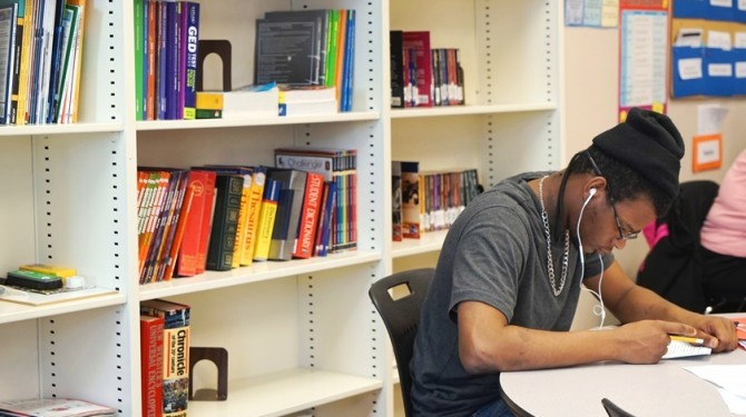 A GED student studies at Seeds of Literacy for his test