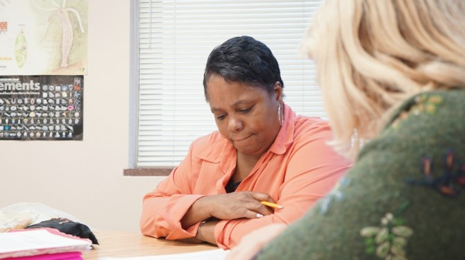 A GED student works with a tutor at Seeds of Literacy.