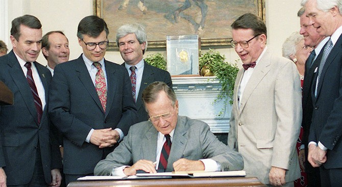 President Bush participates in a signing ceremony for H.R. 751, The National Literacy Act of 1991 (July 25, 1991)