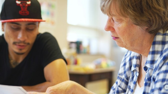 A student and tutor work together for free GED prep.