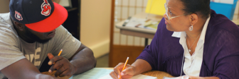 GED graduate Margo Hudson tutors a student at Seeds of Literacy on Cleveland's west side.